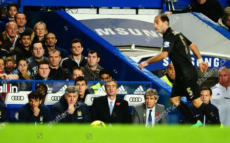 The son of Jose Mourinho, Jose Mario Jr, looks on top left behind the Manchester City bench