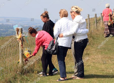 Paul James Charles And Jacqueline Charles Died After Their Car Tumbled Off The Cliff Top At Culver Down On The Isle Of Wight. The Mother Sister Two Daughters And Two Sons Of Paul Charles Lay Flowers At The Point On The Cliff Where The Car Went Over The Top.