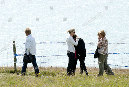 Paul Charles And Jacqueline Charles Died After Their Car Tumbled Off The Cliff Top At Culver Down On The Isle Of Wight. The Mother Sister Two Daughters And Two Sons Of Paul Charles Lay Flowers At The Point On The Cliff Where The Car Went Over The Top.