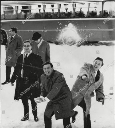 Racing Drivers Playing Snowballs At Cortina In Italy L-r Peter Hughes Jim Clark And Eric Jackson James 'jim' (or 'jimmy') Clark Jr Obe (4 March 1936 Oo 7 April 1968) Was A British Formula One Racing Driver From Scotland Who Won Two World Championships In 1963 And 1965. Clark Was A Versatile Driver Who Competed In Sports Cars Touring Cars And In The Indianapolis 500 Which He Won In 1965. He Was Particularly Associated With The Lotus Marque. He Was Killed In A Formula Two Motor Racing Accident In Hockenheim Germany In 1968. At The Time Of His Death He Had Won More Grand Prix Races (25) And Achieved More Grand Prix Pole Positions (33) Than Any Other Driver. The Times Placed Clark At The Top Of A List Of The Greatest Formula One Drivers In 2009.