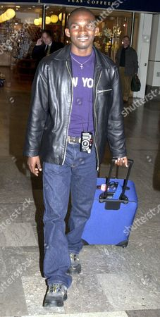 ARRIVAL OF OLYMPIC SWIMMER ERIC THE EEL MOUSSAMBANI FROM PARIS AT LONDON HEATHROW AIRPORT BRITAIN