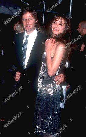 Lena Olin, Lasse Halstrom at the opening night of the Giorgio Armani retrospective at the Guggenheim museum New York - America , 2000