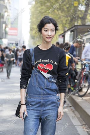 Editorial picture of Street Style at Spring Summer 2014, Milan Fashion Week, Italy - Sep 2013