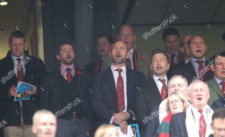 England 2003 World Cup winning squad are reunited at Twickenham and sing the National Anthem L to R from back Iain Balshaw, Andy Gomarsall, Lawrence Dallaglio, Dan Luger, Ben Kay & Jason White (half face)