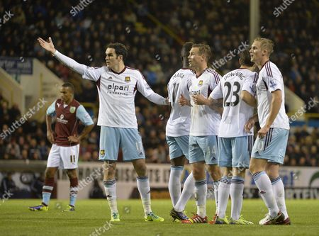Joey O'Brien, Matt Taylor and Jack Collison of West Ham all look for advice from the goalkeeper as they set up the wall.
