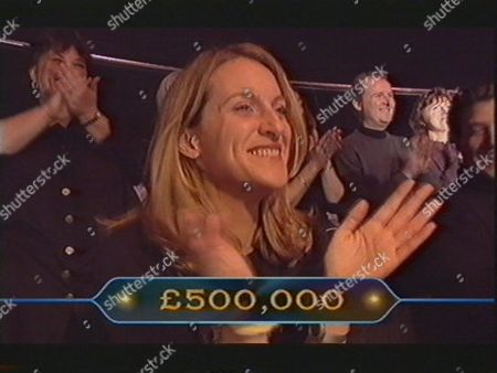 """ROSIE DAUGHTER OF JUDITH KEPPEL APPLAUDS AS HER MOTHER ANSWERS THE HALF MILLION POUND QUESTION CORRECTLY ON """" WHO WANTS TO BE A MILLIONAIRE"""" BRITAIN"""
