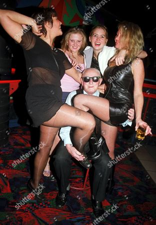 85 YEAR OLD FRED WHITTINGHAM WITH YOUNG CLUBBERS AT THE BALCONY NIGHT CLUB, RYDE ISLE OF WIGHT,BRITAIN.