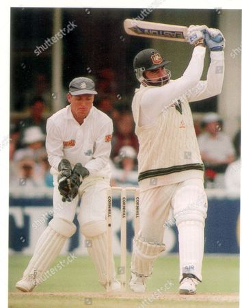 Stock Image of Mervyn Hughes Cricketer In Action For Australia During The 5th Ashes Test At Edgbaston. England's Alec Stewart Keep's Wicket. Pkt 1149 - 36273.