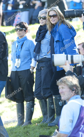 A Happy Holly Sweeney (centre Striped Top) After Partner Rory Mcilroy Halved The Match On The 18th Green At The 2010 Ryder Cup Celtic Manor Resort Newport South Wales. 2010 Ryder Cup... Day Four.
