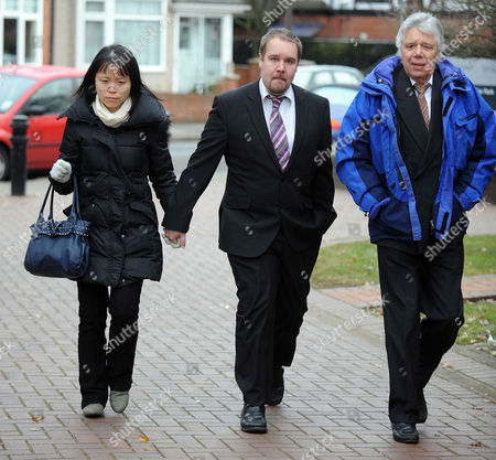 Anthony Jones Arrives At Isleworth Crown Court With His Wife Daisy. Re Drunken Flight To China. Anthony's Father Michael Is In Blue Coat.
