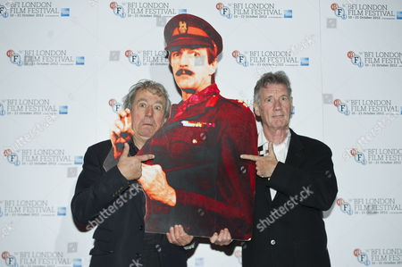 Terry Jones And Michael Palin At The Screening Of A Liar's Autobiography Empire Cinema Leicester Square London. They Are Holding A Cardboard Cut Out Of The Author Graham Chapman.