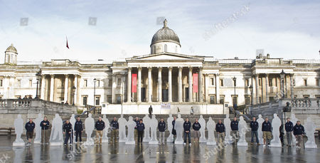 Editorial image of A Battalion Of Statues Honouring Wounded Servicemen And Women At Trafalgar Square Ahead Of Heroes Day. Pic Shows (l-r): David Scott Simon Brown Duncan Moyse Colin Luther-davies Rory Mackenzie Dan Richards Colin Henshaw Liz Taylor Chris Fleet Brian Yo