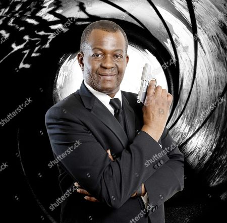 Daily Mail Showbiz Writer Baz Bamigboye As James Bond Complete With Walther Ppk Gun.