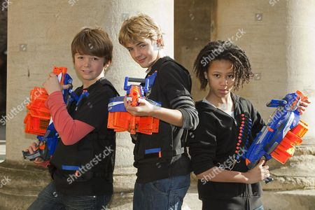 Stock Photo of 2012's Top Toys For Christmas -(left To Right ) Harry Ashley (13) Harry Wallace (12) And Caius Duncombe (10) With Nerf N-strike Eliter Hail-fire By Hasbro.