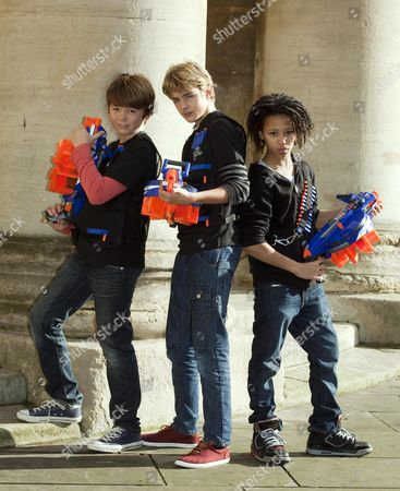 Stock Picture of 2012's Top Toys For Christmas -(left To Right ) Harry Ashley (13) Harry Wallace (12) And Caius Duncombe (10) With Nerf N-strike Eliter Hail-fire By Hasbro.