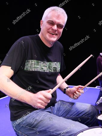 Gadget Show Presenter Jon Bentley plays the drums