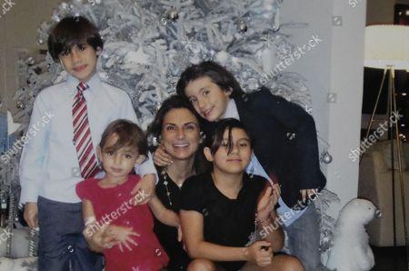 Maude Versini and her children