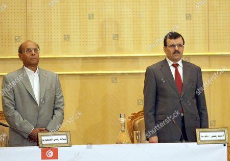 Tunisia's President Moncef Marzouki (L) and Prime Minister Ali Laarayedh