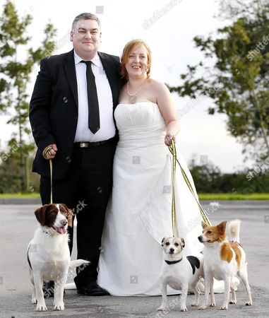 Graham Farrell and Catherine Keating with their pet dogs Poppy, Cara and Renny