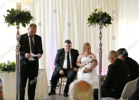Graham Farrell, Catherine Keating and Poppy during the ceremony