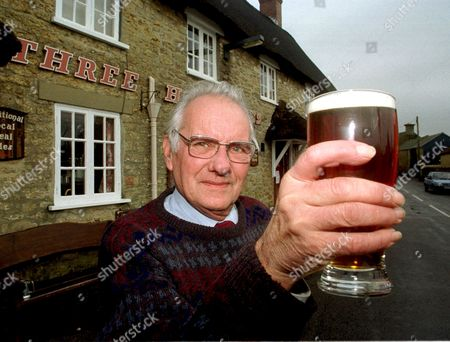 67 YEAR OLD DAVID ROPER WHO HAS NOT MISSED A NIGHT AT THE THREE BELLS PUB, BURTON BRADSTOCK, DORSET FOR FIFTY YEARS, BRITAIN - 01/01