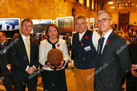 Jeffrey Donaldson MP, Culture Secretary Maria Miller, photographer Mike St. Maur Sheil, Lord Faulkner and Dr. Andrew Murrison MP with the Loos Football