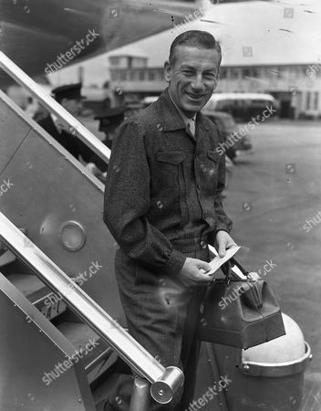 Hoagy Carmichael (howard Hoagland Carmichael) American Musician And Composer Of 'stardust' Seen Arriving At London Airport For A Variety Tour Of England. Glass Neg.