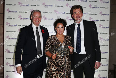 CEO of Stonewall Ben Summerskill with Journalist of the year award to Grace Dent