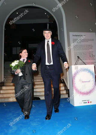 Susan Calman and CEO of Stonewall Ben Summerskill walk off after the awards dressed as if they are getting married