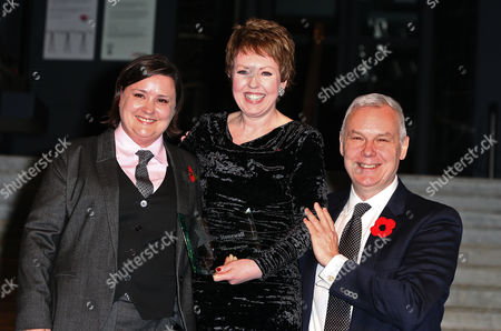 Susan Calman and CEO of Stonewall Ben Summerskill present the Politician of the Year to Tina Stowell, Baroness Stowell of Beeston