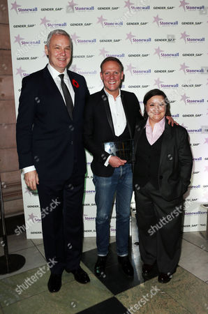 Susan Calman and CEO of Stonewall Ben Summerskill with the Entertainer of the Year award winner Antony Cotton