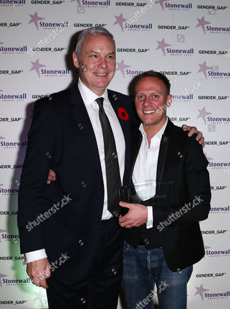 CEO of Stonewall Ben Summerskill with the Entertainer of the Year award winner Antony Cotton