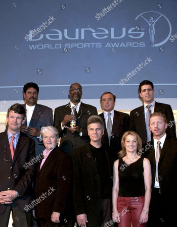 Kapil Dev, Edwin Moses, Hugo Porta, Migual Indurain (front row) Morne du Plessis, Dawn Fraser, Mark Spitz, Nadia Comaneci and Boris Becker: THE WORLD SPORTS ACADEMY AT LAUREUS WORLD SPORTS AWARDS NOMINATIONS PRESS CONFERENCE IN BERLIN, GERMANY - 13/03/01