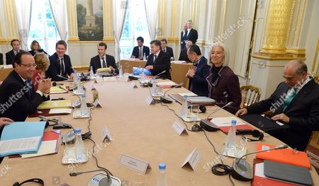 Francois Hollande, Pascal Canfin, Emmanuel Macron, Guy Ryder, Jin Yong Kim, Christine Lagarde and Jose Angel Gurria