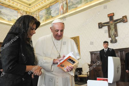 Stock Picture of Laura Chinchilla and Pope Francis I exchange gifts