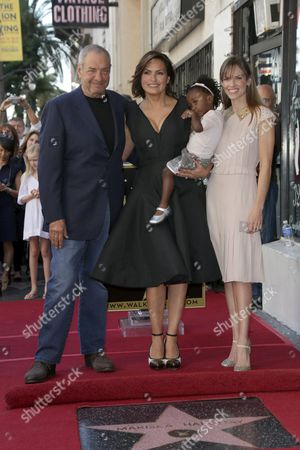 Dick Wolf, Mariska Hargitay with daughter Amaya Josephine Hargitay Hermann, and Hilary Swank