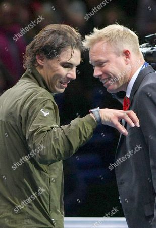 Rafael Nadal of Spain gestures with Mark Petchey during the ATP World Tour Finals at the 02 Arena, 2013