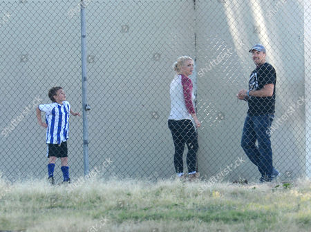 Britney Spears, David Lucado and Jayden Federline playing with a tennis ball