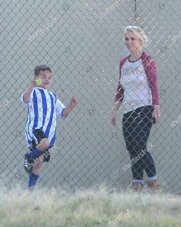 Britney Spears and Jayden Federline playing with a tennis ball