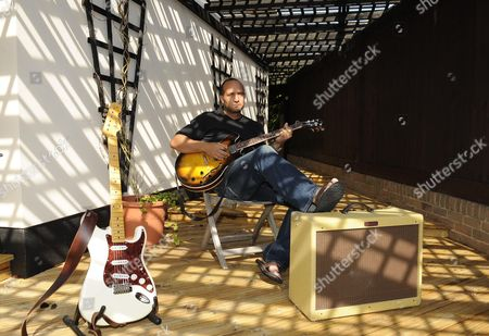 Ex Surrey And England Cricketer Mark Butcher At Home Playing The Guitar. Mark Alan Butcher (born Croydon London 23 August 1972) Is An English Test Cricketer Who Played County Cricket For Surrey From 1992 Until His Retirement From The Sport In 2009. He Was A Left-handed Batsman And Occasional Right-arm Medium-pace Bowler. Butcher Is Also A Guitar-player And Singer - He Sang A Ballad At Surrey And England Team-mate Ben Hollioake's Funeral. In Early 2008 He Started Recording His Debut Album Which Will Include 'you're Never Gone' The Song He Wrote In Tribute To Hollioake.