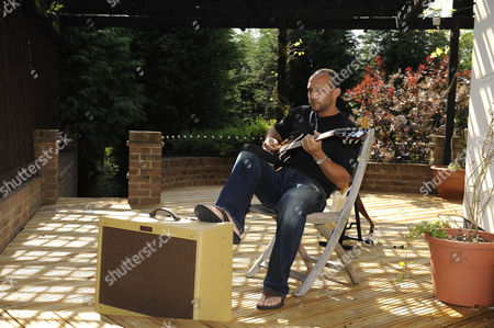Ex England Cricketer Mark Butcher At Home Playing The Guitar.