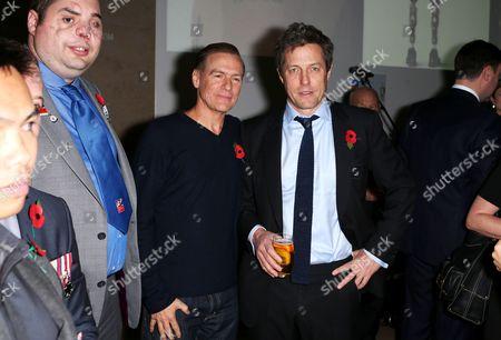 Hugh Grant and Bryan Adams with veterans