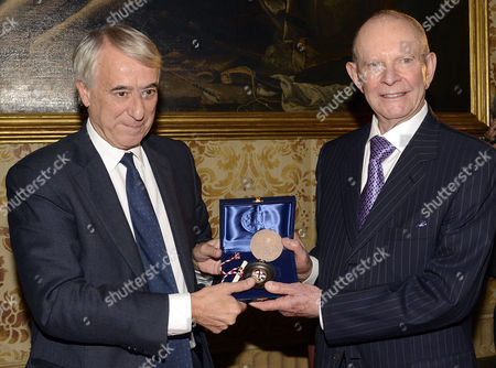 The mayor of Milan Giuliano Pisapia presents the Seal of the City of Milan to Wilbur Smith