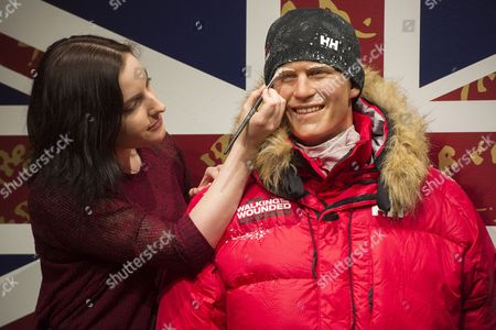 Stock Picture of An artist puts the finishing touches to the Prince Harry wax figure
