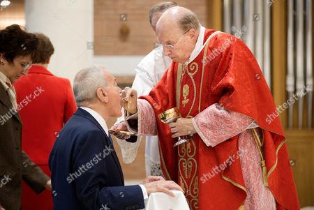 Bishop Javier Echevarria Rodriguez gives Communion to Gianni Letta