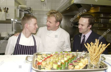 GORDON RAMSAY WITH MARCUS WAREING, THE CHEF AT 'PETRUS', AND TRAINEE CHEF RICHARD EDWARDS IN THE KITCHEN OF RAMSAY'S RESTAURANT
