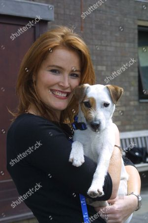 SHAUNA LOWRY WITH ROCKY, ONE OF THE DOGS FEATURED IN THE CAMPAIGN TO REDUCE THE NUMBER OF DOGS ABANDONED DURING THE SUMMER HOLIDAYS