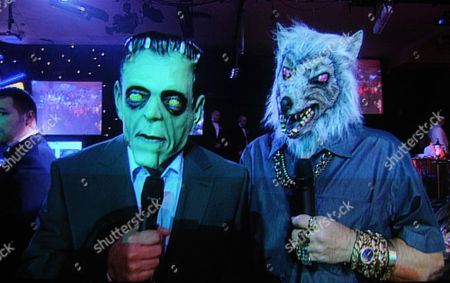 Ray Stubbs And His Sidekick George Wearing Halloween Masks To Start The British Darts Organisation Event At Lakeside Country Club.
