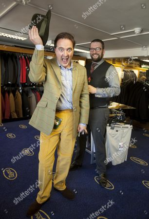 Editorial picture of Daily Mail Feature Writer Guy Walters Is Measured By Richard Cole One Of The Owners Of The Famous Gentleman's Outfitters In Cheltenham Which Is Closing Down After 126 Years.