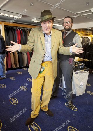Stock Picture of Daily Mail Feature Writer Guy Walters Is Measured By Richard Cole One Of The Owners Of The Famous Gentleman's Outfitters In Cheltenham Which Is Closing Down After 126 Years.